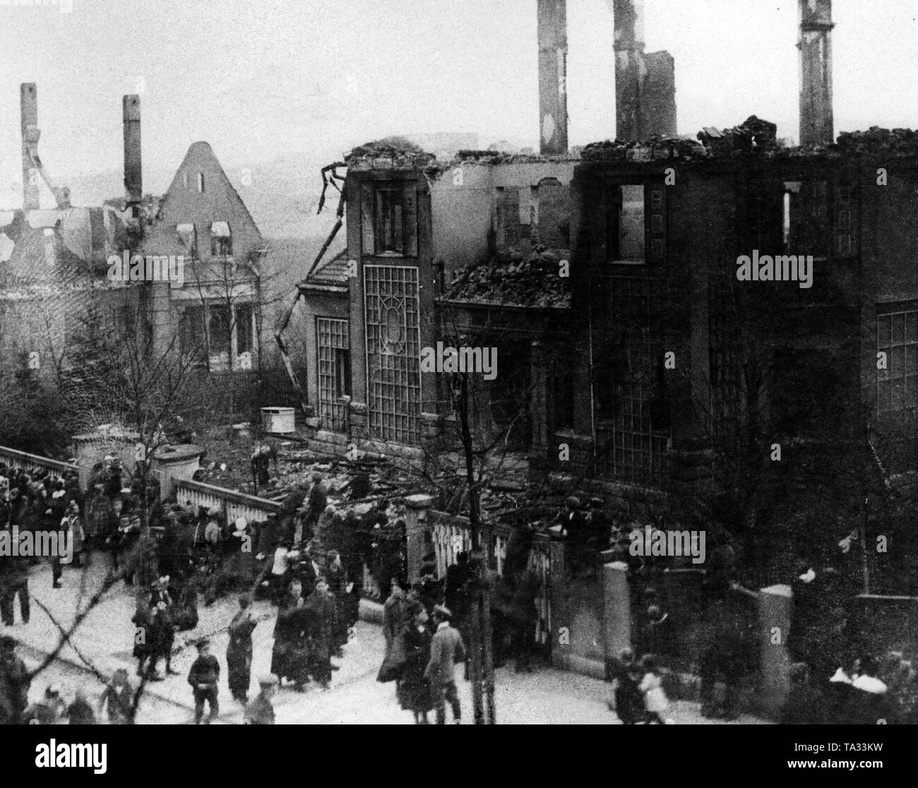 Most of the followers of Max Hoelzl come from the completely impoverished population in the Vogtland. Here also occurred unrests and attacks on the possession of some people particularly hated by the population.This photograph shows the villas of the merchant Franz Lange and the Baumeister Baumann in Falkenstein in Vogtland that were set on fire by the Communists. - Stock Image
