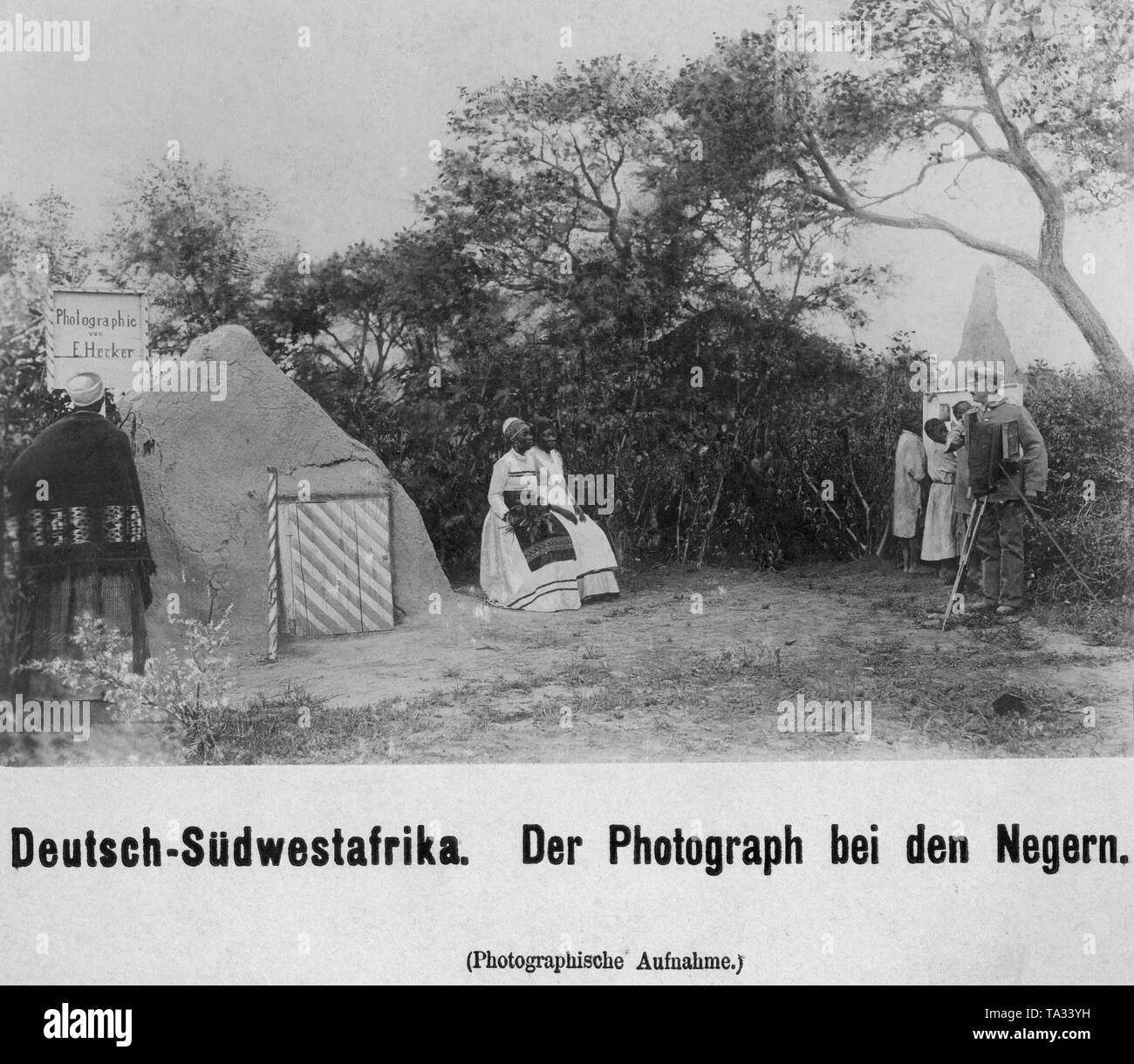 The photographer E. Hecker photographs local women in European clothing in German Southwest Africa. Stock Photo