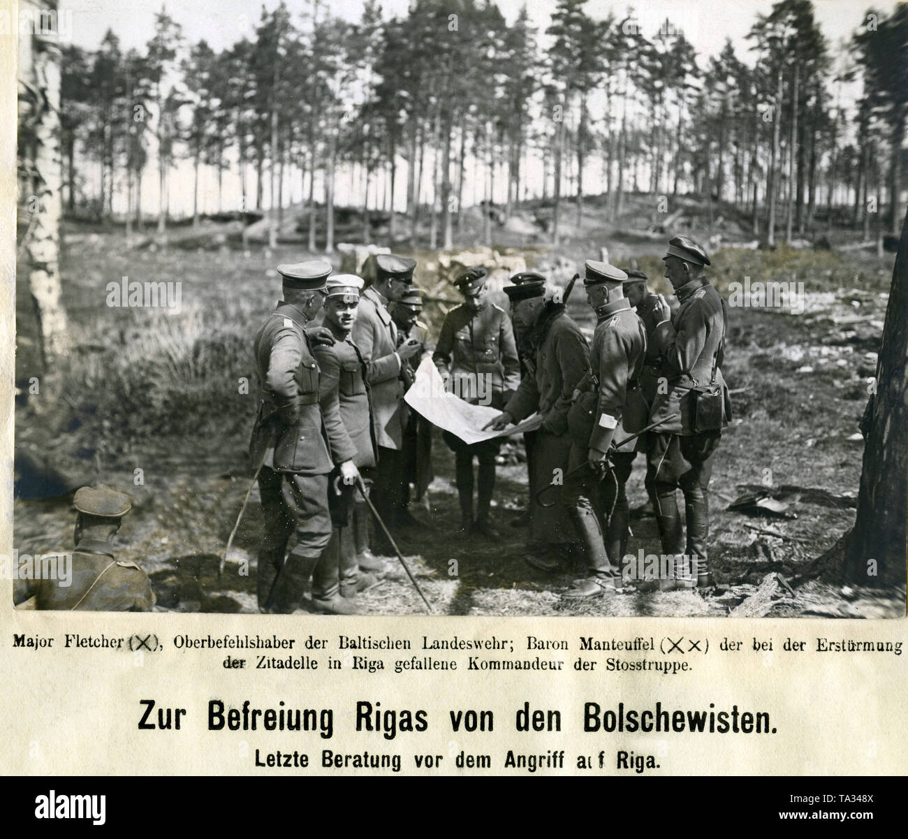 """The military leaders of the Free Corps """"Iron Division"""" and the Baltic Landeswehr consult one last time before the attack on Riga. Among them was the commander-in-chief, Major Alfred Fletcher and Hans Baron Manteuffel-Szoege, the commander of the battalion that fell during the storming of the Citadel in Riga. Stock Photo"""