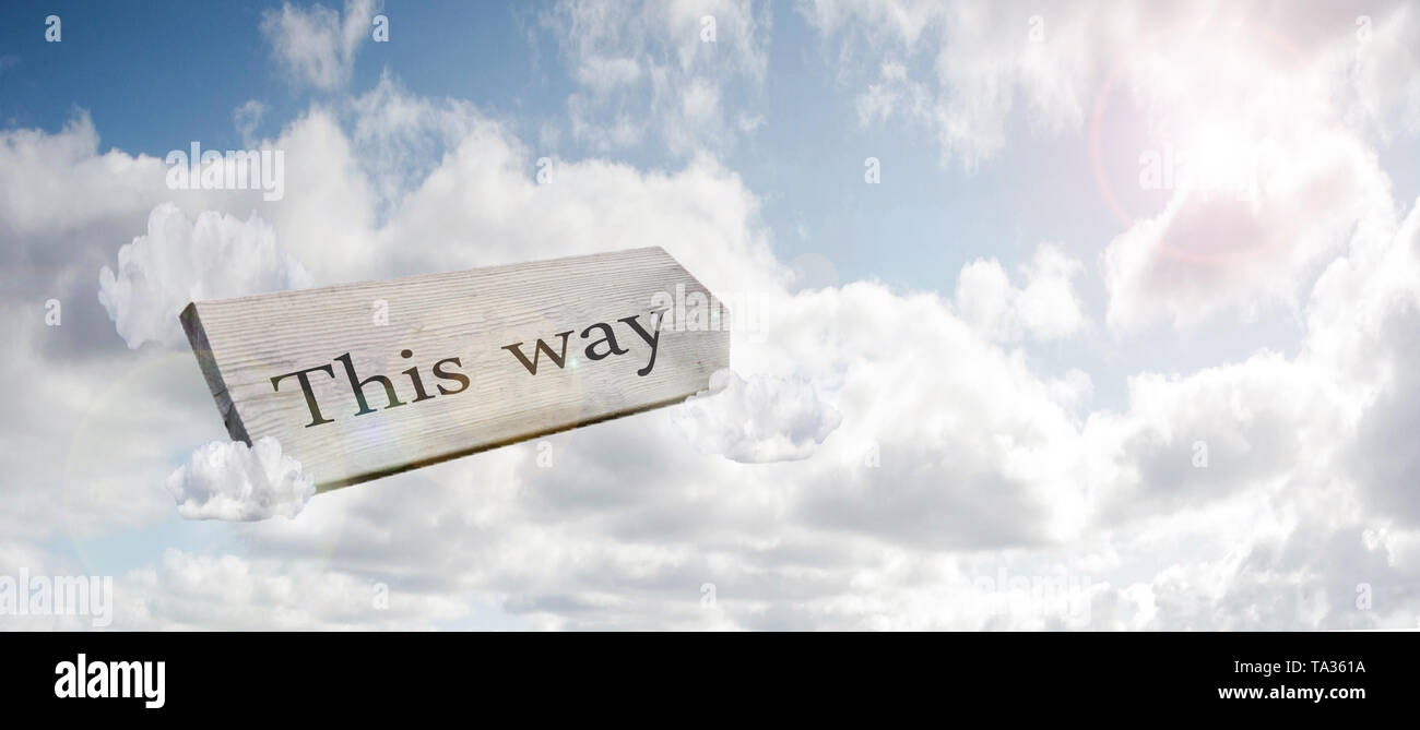 Crossroad signpost saying this way concept for lost, confusion or decisions in the blue sky colorful - Stock Image