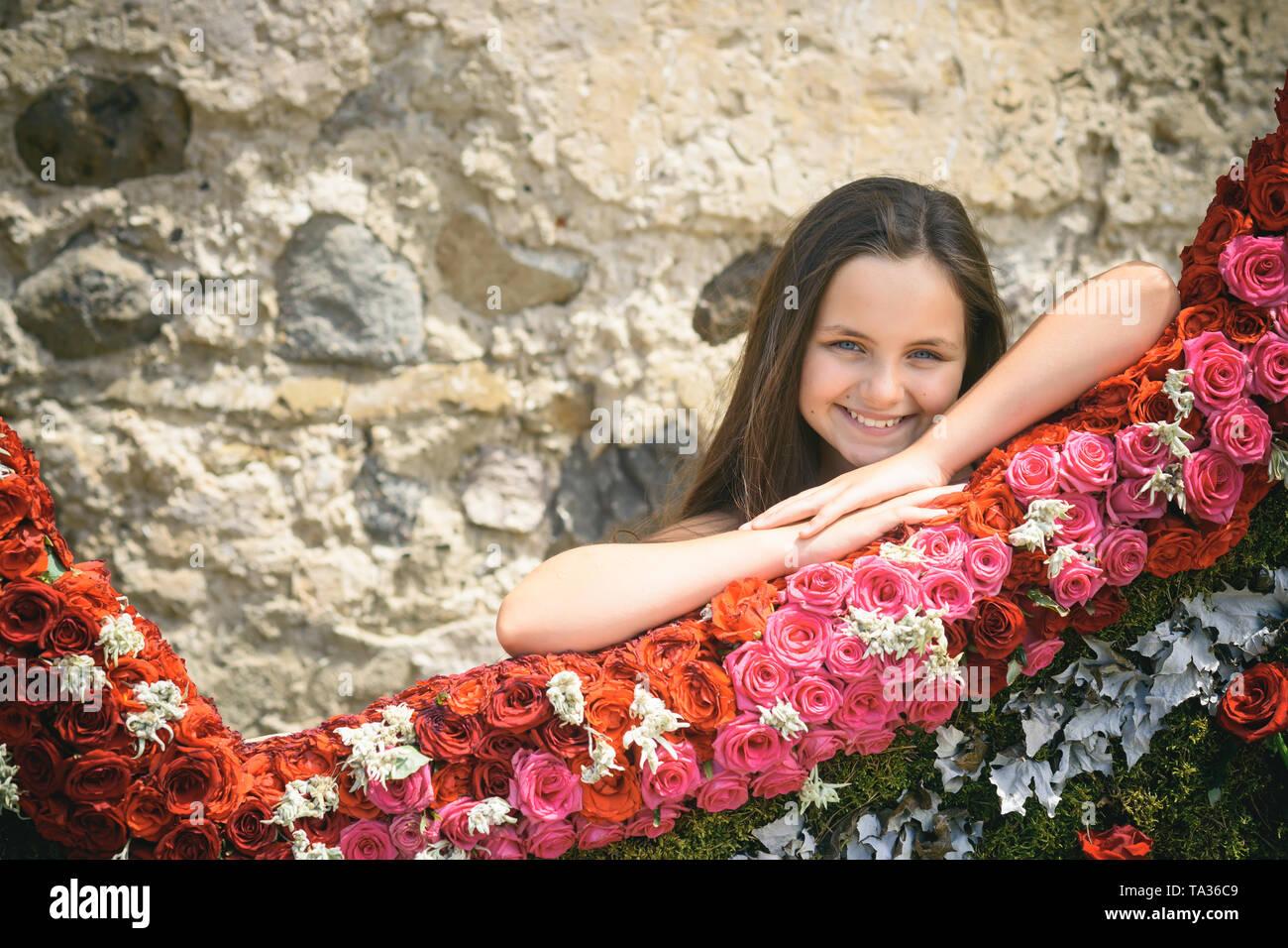 Floral design and little child, floristic, floral shop - Stock Image