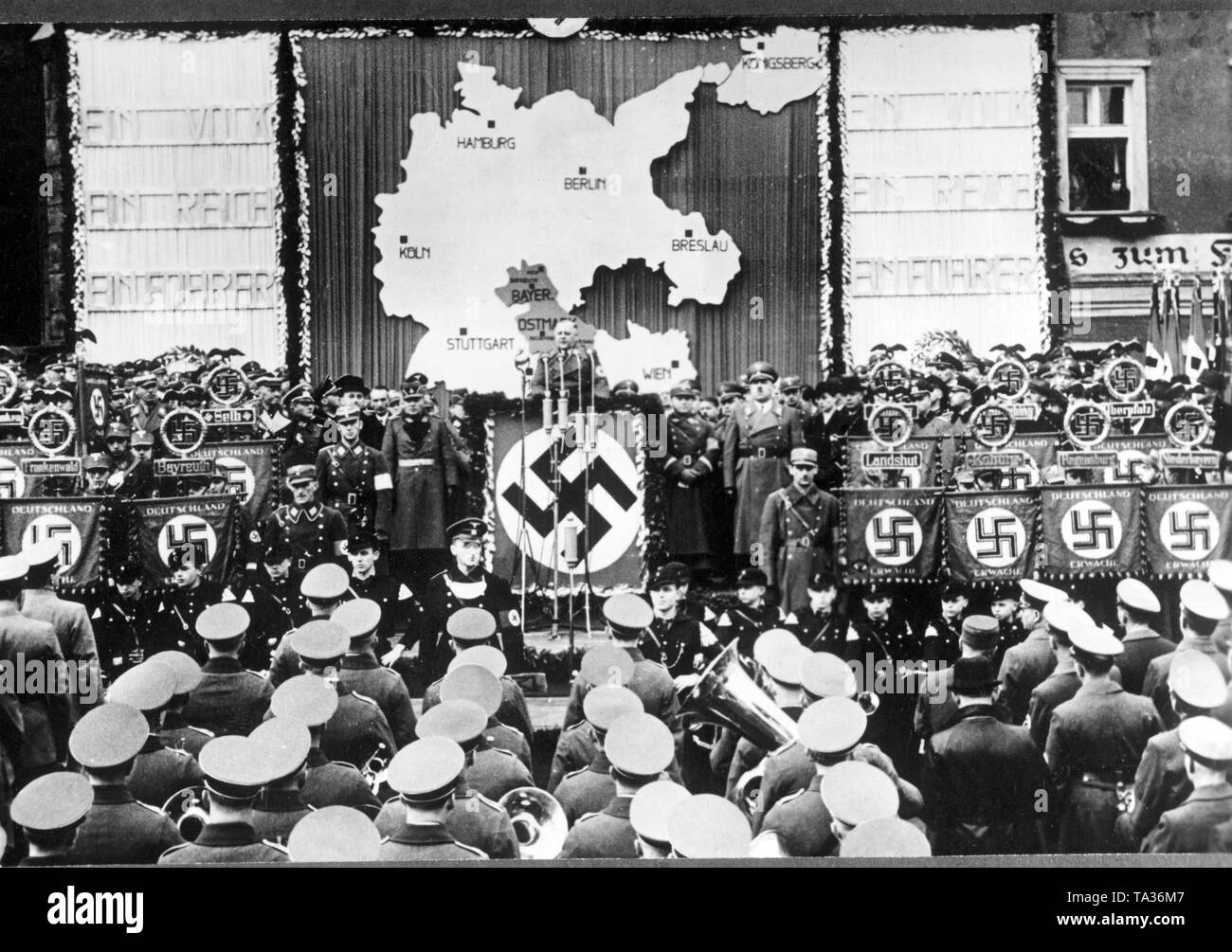 In Prachatice takes place the solemn takeover of the Bohemian Forest by the Gauleiter of the Bavarian Ostmark, Fritz Waechtler (at the lectern). 20,000 party members of the Gau region attend this event in their local groups in collective reception. - Stock Image