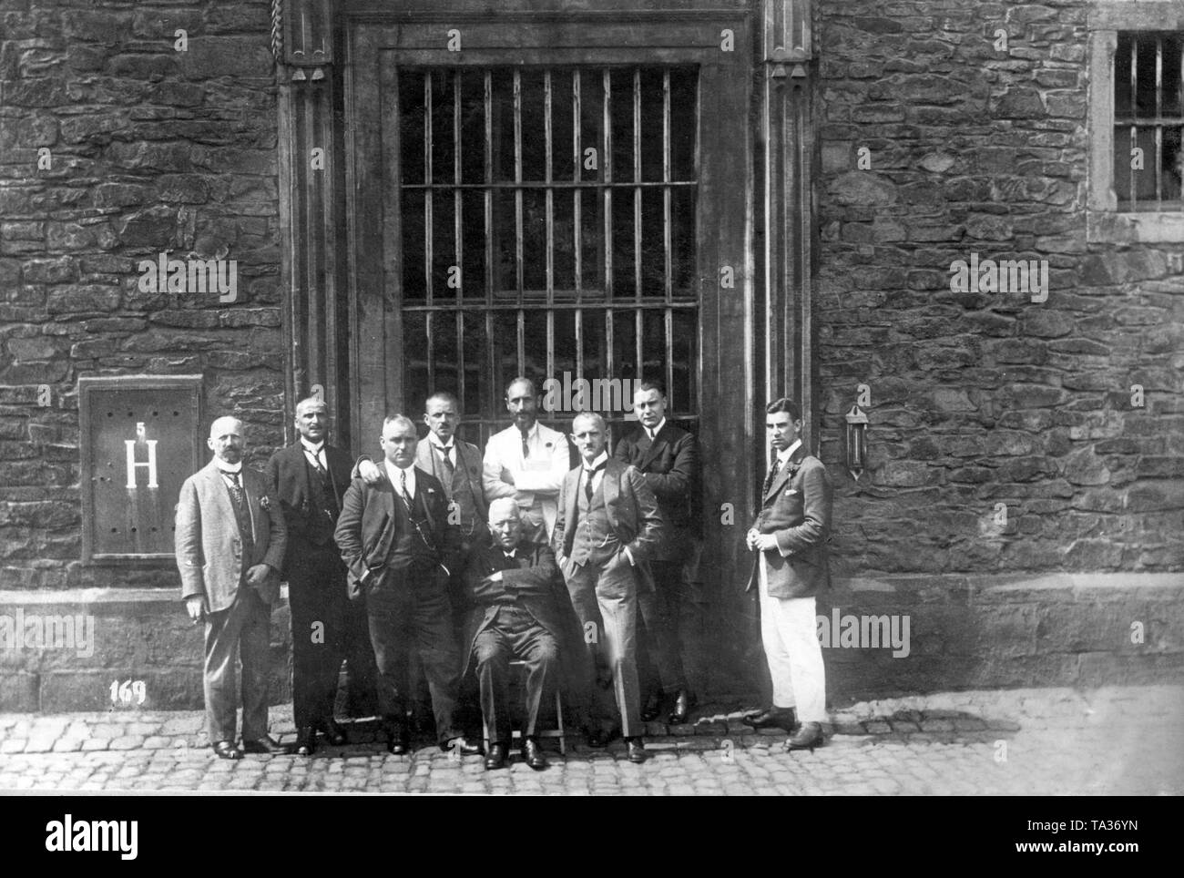 Group photo of several high-ranking municipal and state officials who were sentenced to prison by a French military court. They are posing in front of the penitentiary, where they have to serve time (Undated photo). - Stock Image