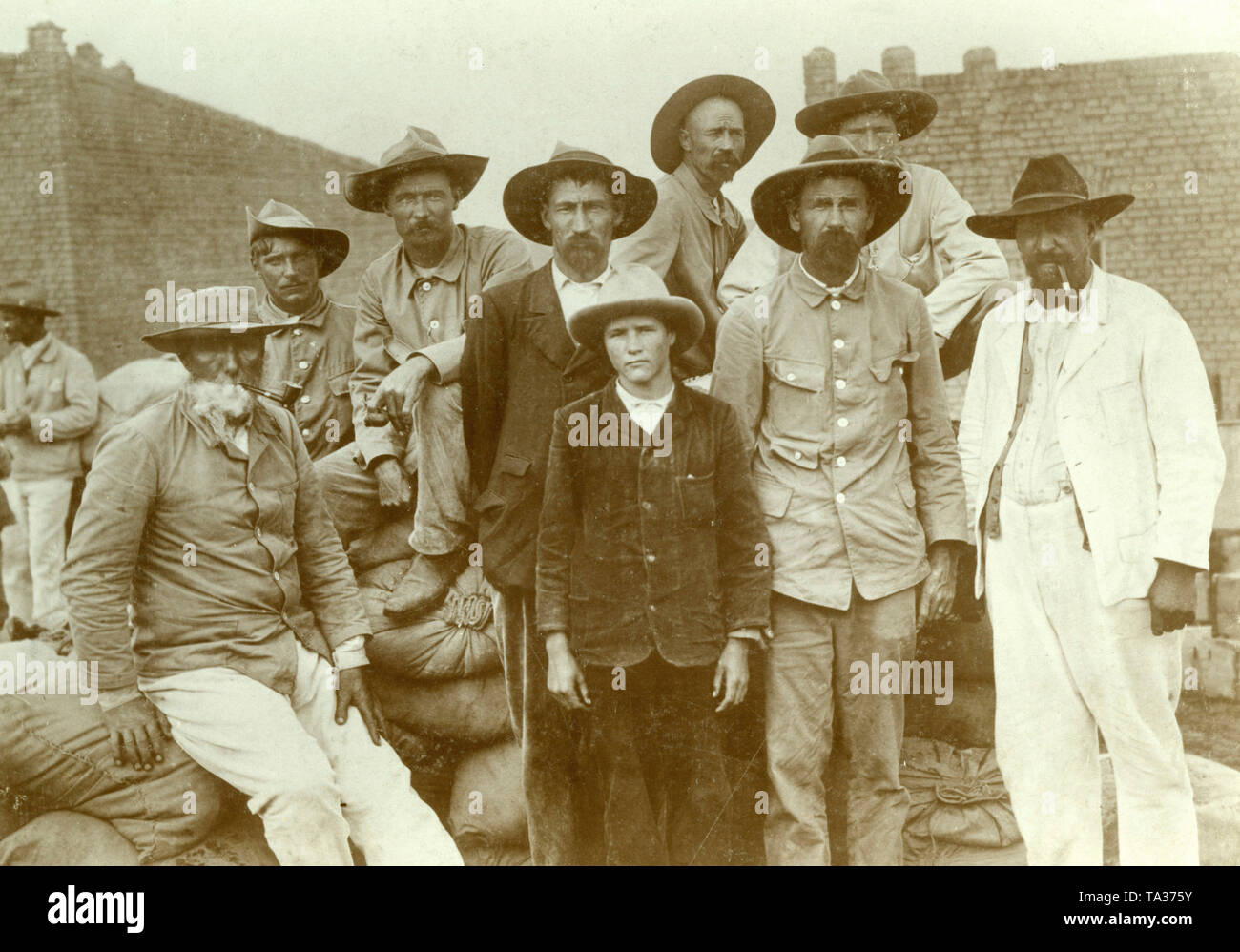 Boer men working for German colonialists in German South West Africa. - Stock Image
