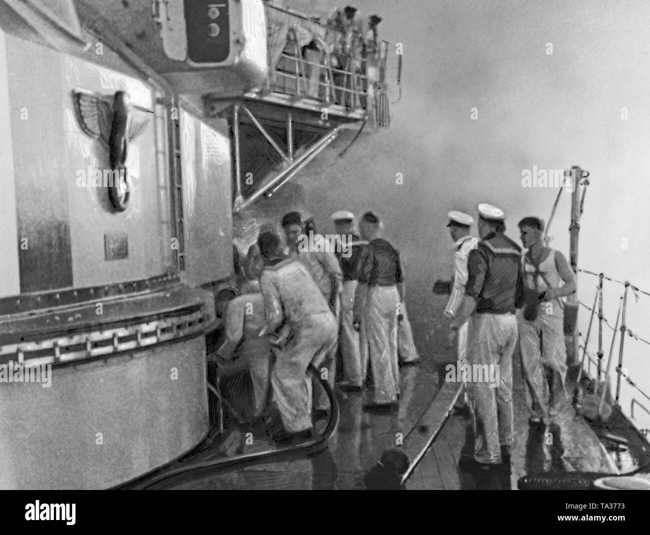 Photoof a group of sailors during cleaning-up and fire-fighting operations on the deck of'Deutschland' after the bomb attack in the port of the Balearic Island of Ibiza on the 29th of May, 1937. To the left, the side of thefront turret (decorated with the imperialeagle and a swastika). In the background, billowing smoke. - Stock Image