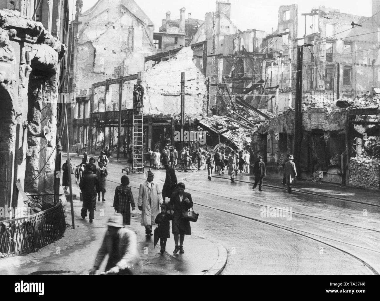 The Theatinerstrasse corner Maffeistrasse in Munich after the end of the war. - Stock Image