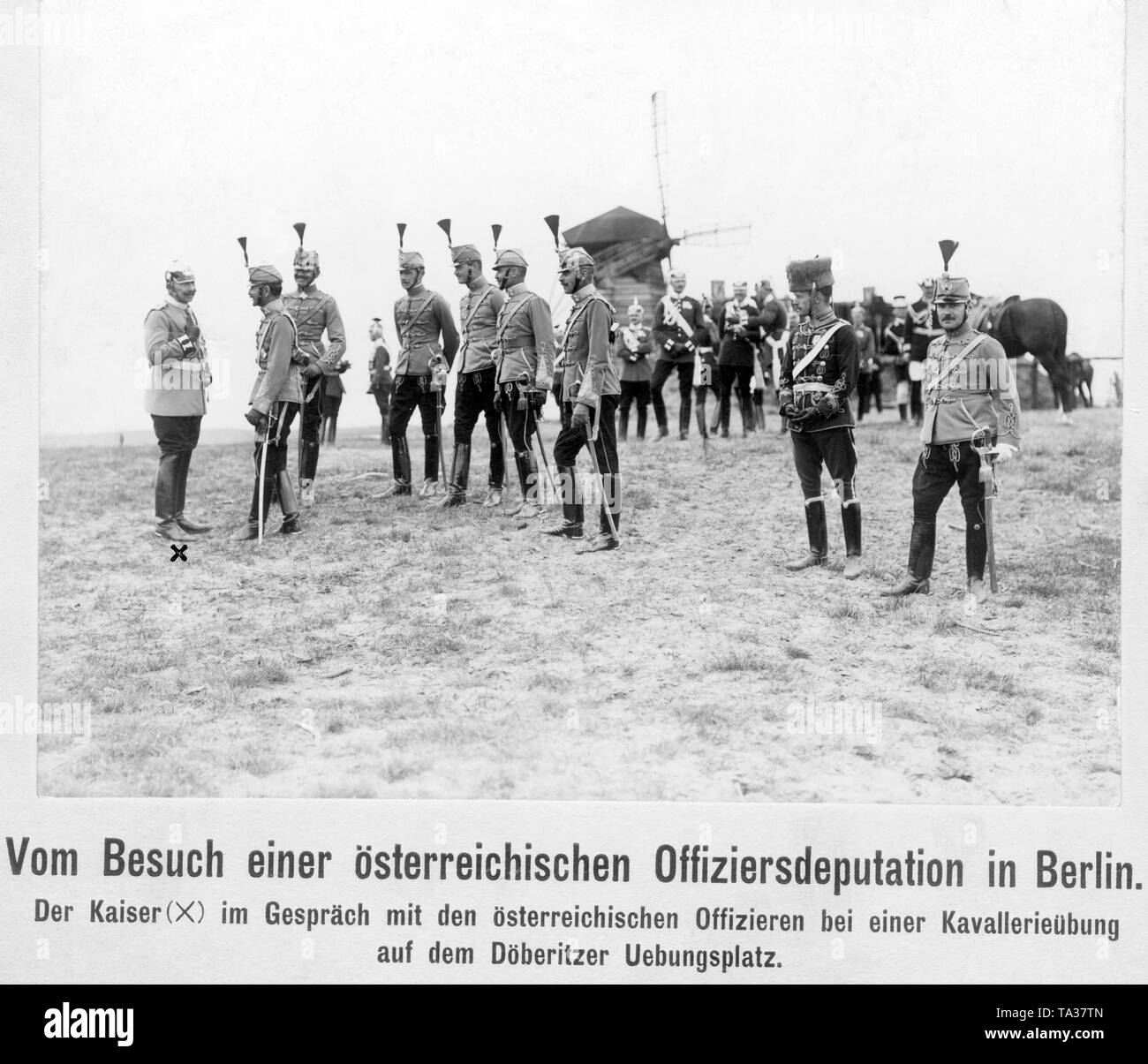 Emperor WilliamII (far left) in conversation with a deputation of Austrian officers in a cavalry exercise on the military training ground in the Doeberitz heath west of Berlin. - Stock Image