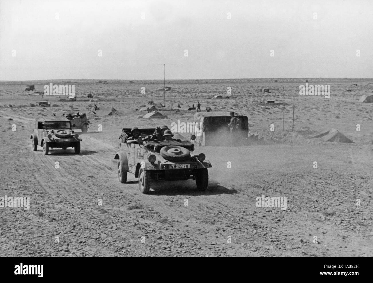 Three VW Kuebelwagen in a desert landscape in North Africa. - Stock Image