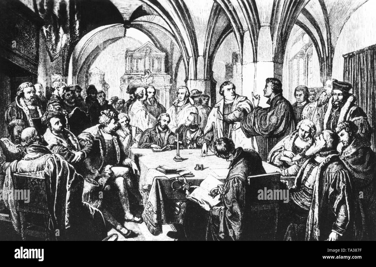 This illustration from the 19th century shows the colloquy in Marburg in 1529 between Martin Luther and Ulrich Zwingli. The interpretation of the doctrine of the Lord's Supper divided the two faith leaders. - Stock Image