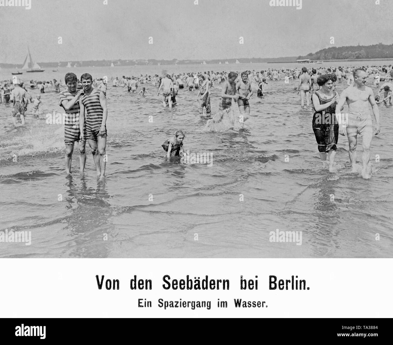 Bathers in a seaside resort at the lake Wannsee. - Stock Image