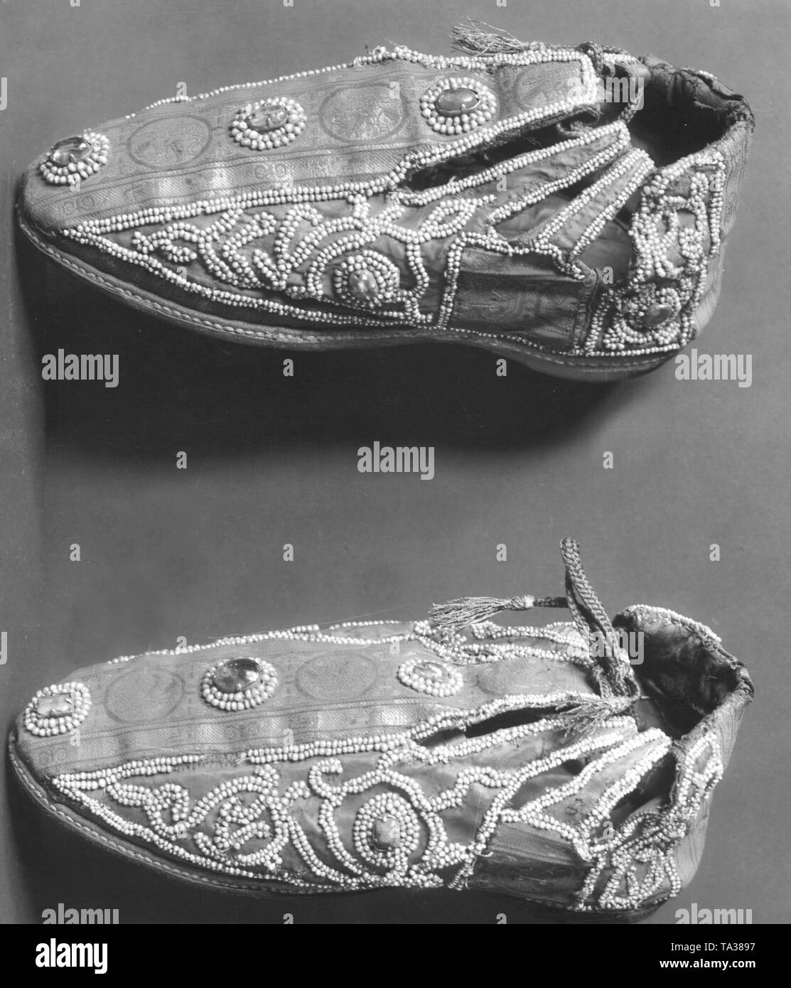 Shoes of the coronation robes, beside the clothes the regalia also includes the imperial insignia. The coronation regalia was worn at the coronation ceremony. - Stock Image