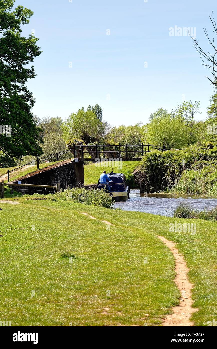 The River Wey Navigation near Ripley with a narrow boat approaching Papercourt lock on a sunny summers day, Surrey England UK - Stock Image