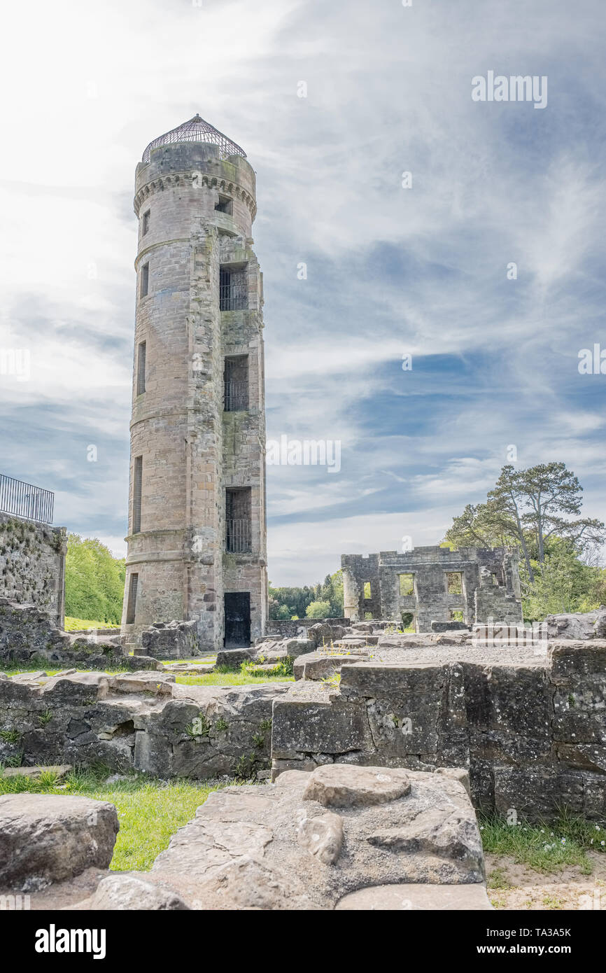 Ancient ruins and green trees at Eglinton Castle  Irvine North Ayrshire Scotland. - Stock Image
