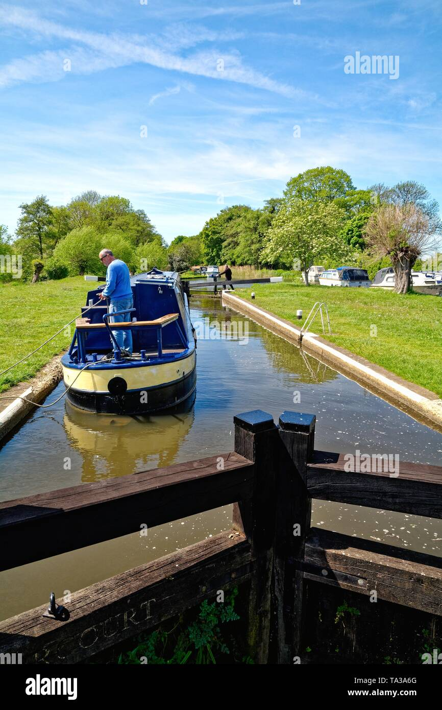 A narrow canal boat passing through Papercourt lock on the River Wey Navigation at Ripley Surrey England UK - Stock Image