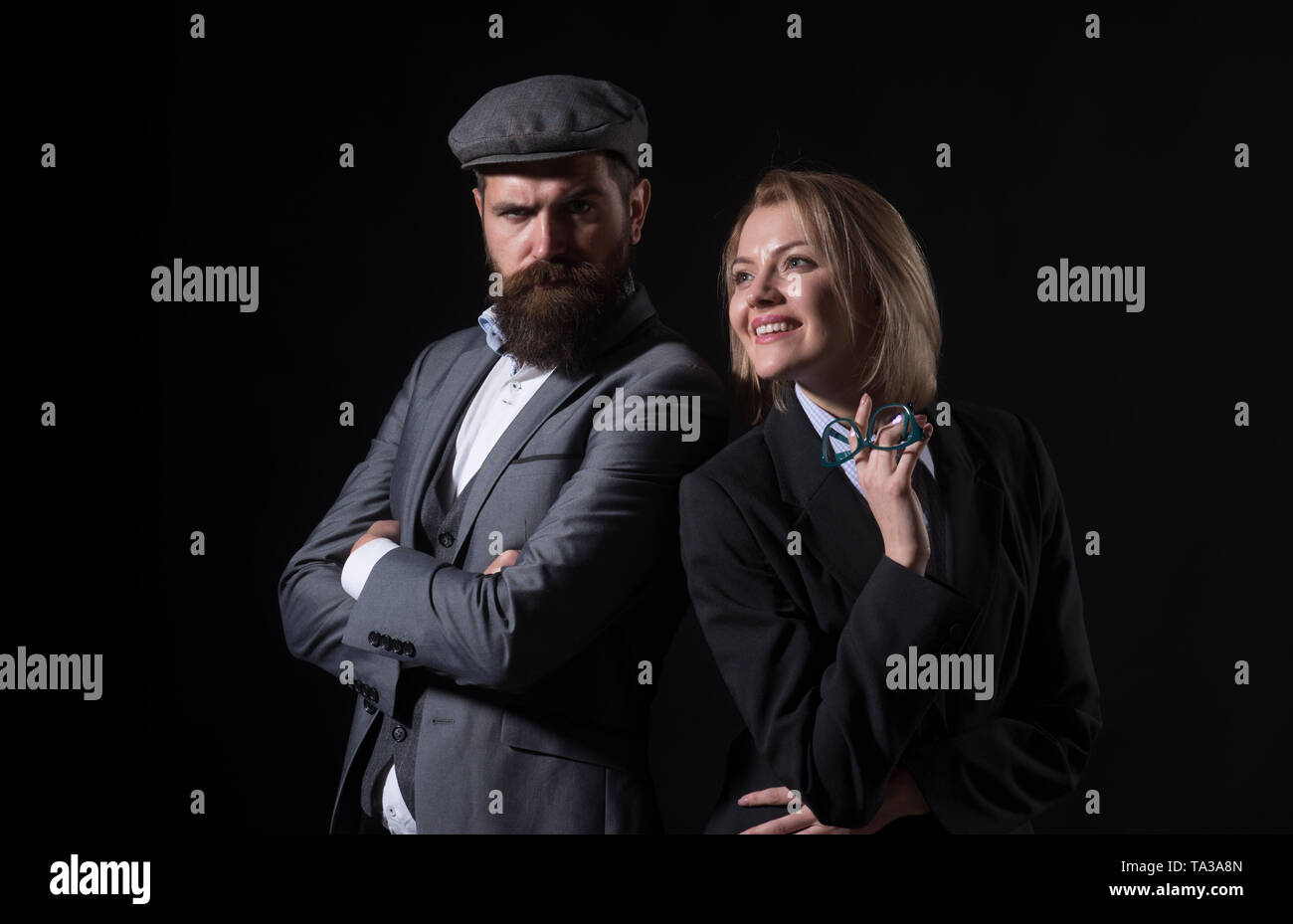 Man and woman in oldfashioned suit and hat - Stock Image