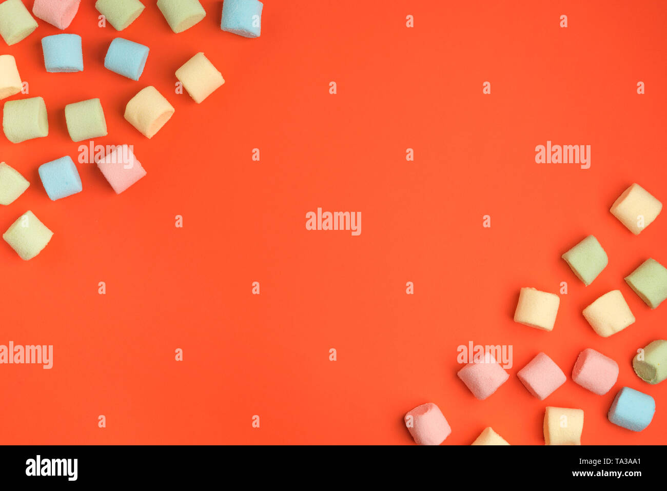 Coral paper background with marshmallow. Cozy sweet background - Stock Image