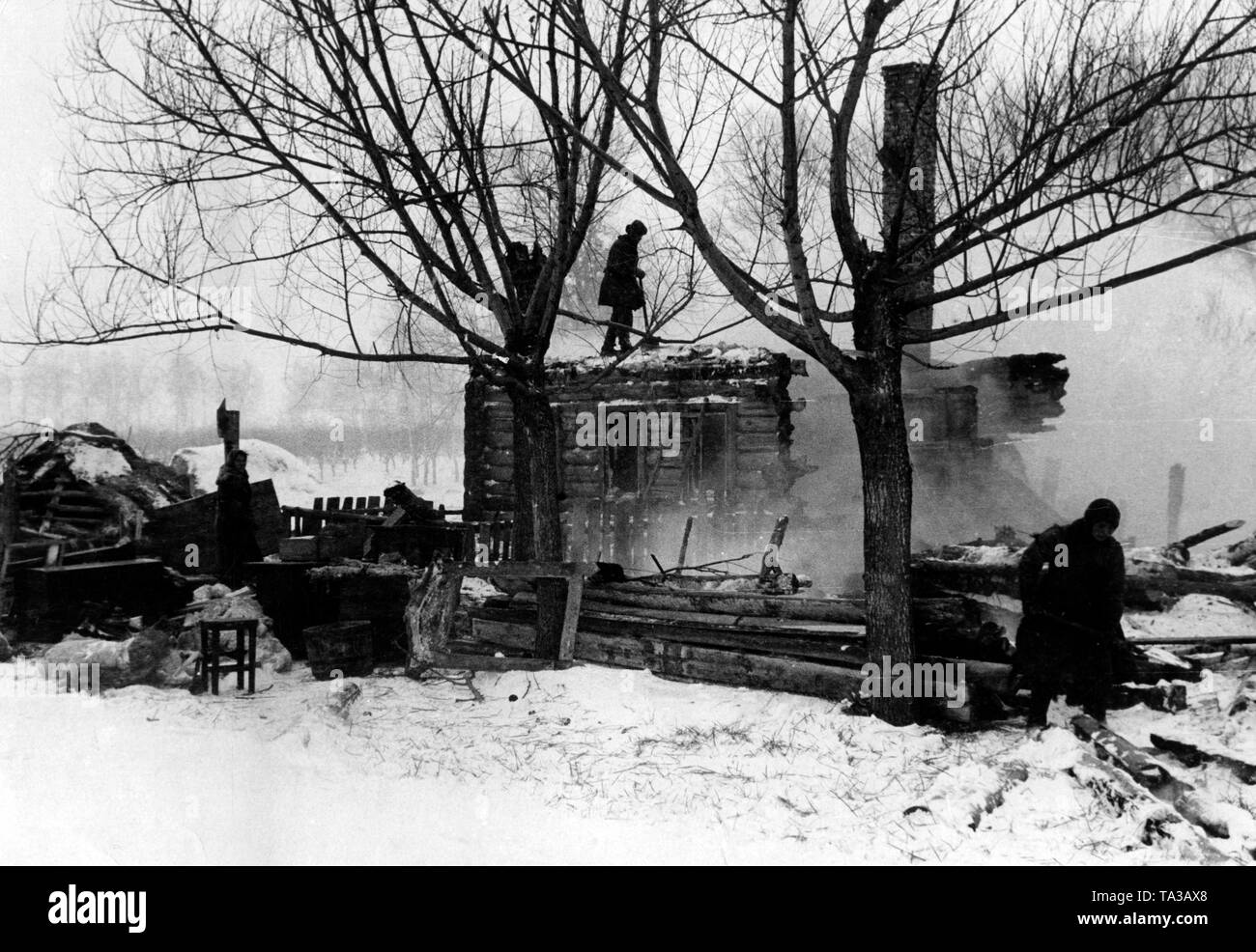 German soldiers are looking for a possible accommodation near Moscow. They are on the retreat and meet countless destroyed villages. Stock Photo