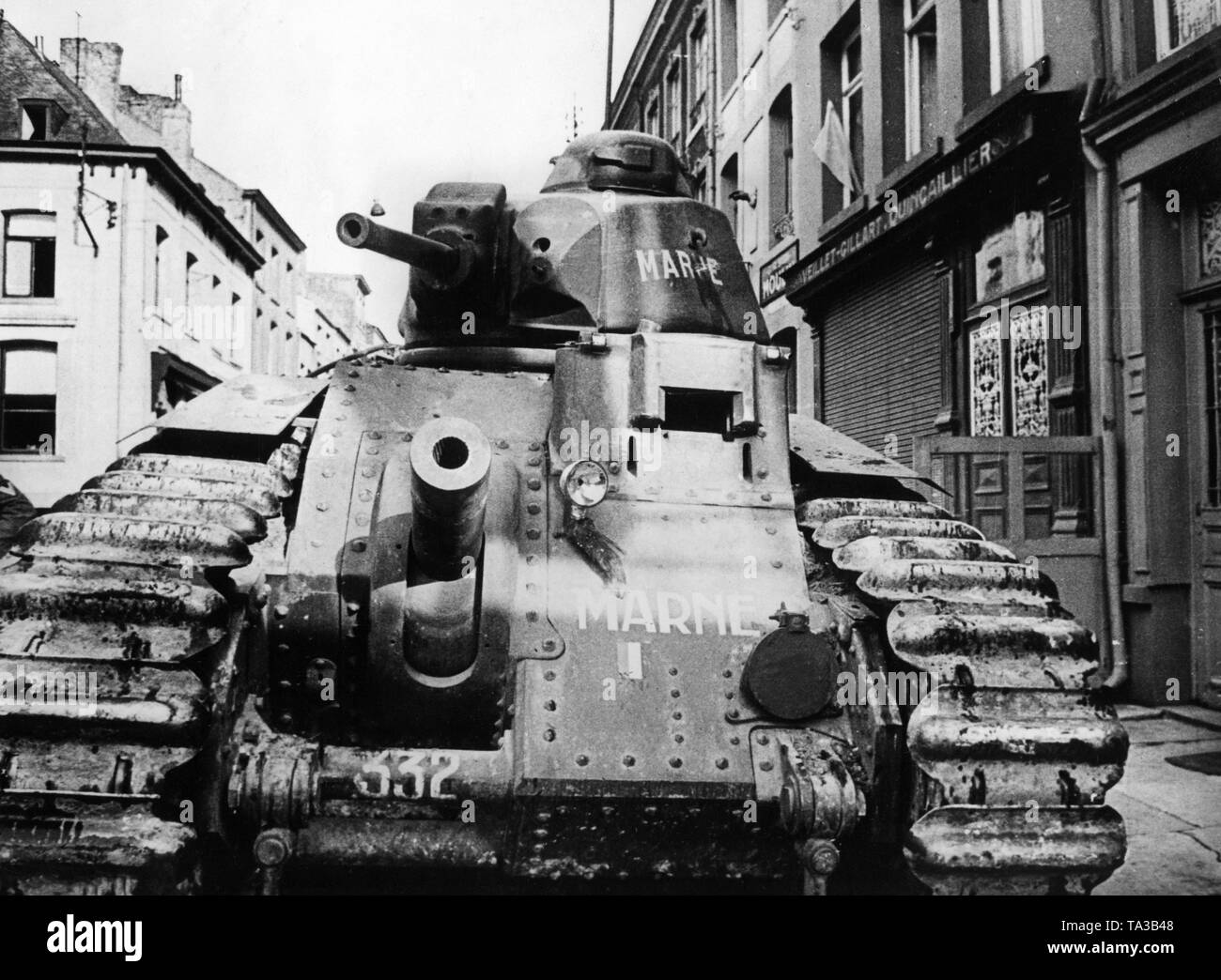 Renault Char B1 destroyed by a Stuka attack in a French village. Stock Photo