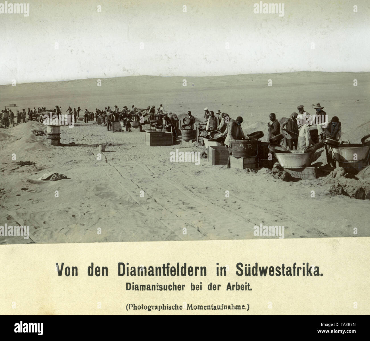 Workers in the search for diamonds on the diamond fields in German South West Africa. - Stock Image