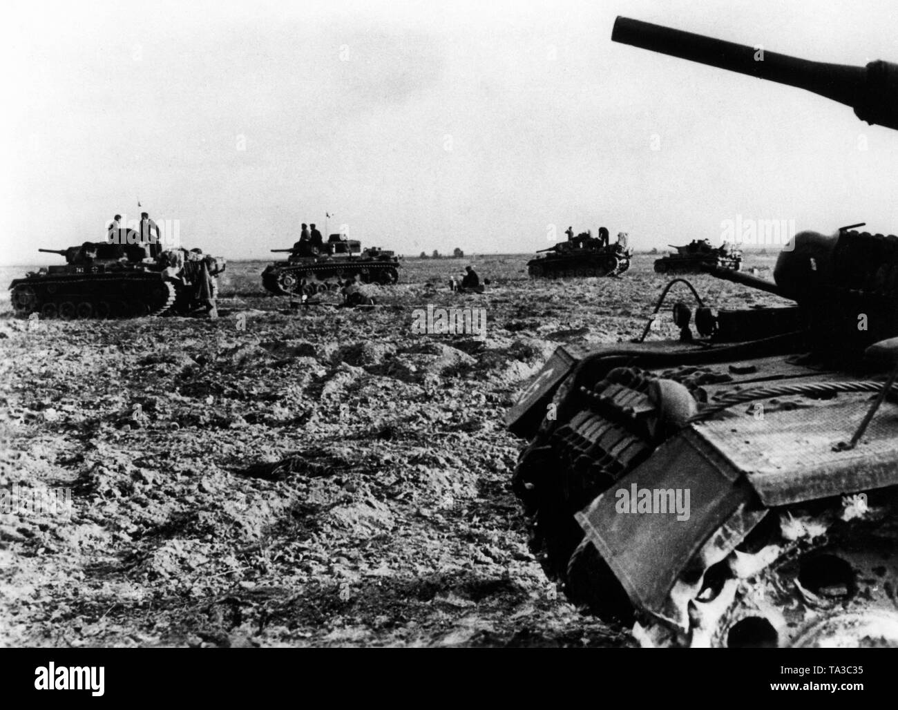 Panzer III of the 10th Panzerdivision secure a wing against Russian counter-attacks. Stock Photo