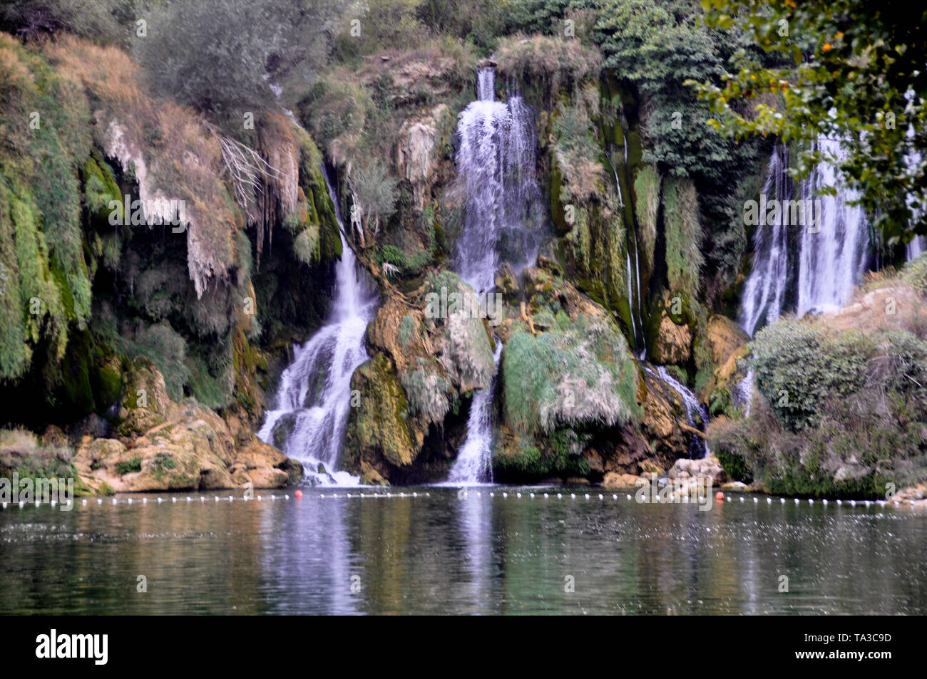 Beautiful Kravica waterfall in Bosnia and Herzegovina - popular swimming and picnic area for tourists - Stock Image