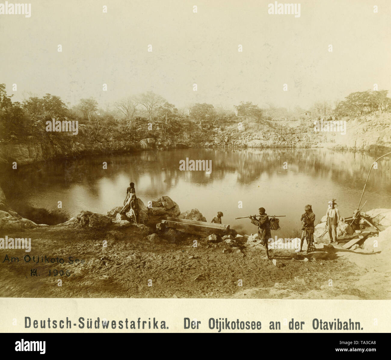 Boys and girls in some European clothing at the Otjikoto Lake in German Southwest Africa. - Stock Image