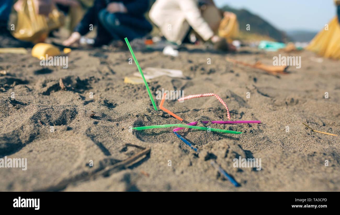 Straws on the beach - Stock Image