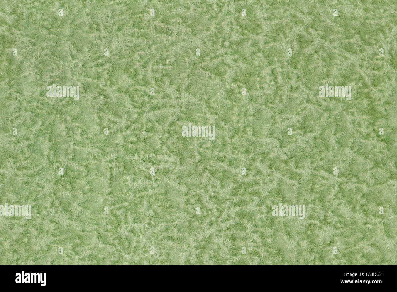 Seamless texture of soft polyester green single-color furniture upholstery with random pattern - Stock Image