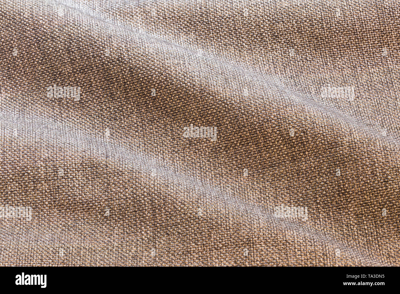 Brown waves dense rough fabric background, close up without any blurring - Stock Image