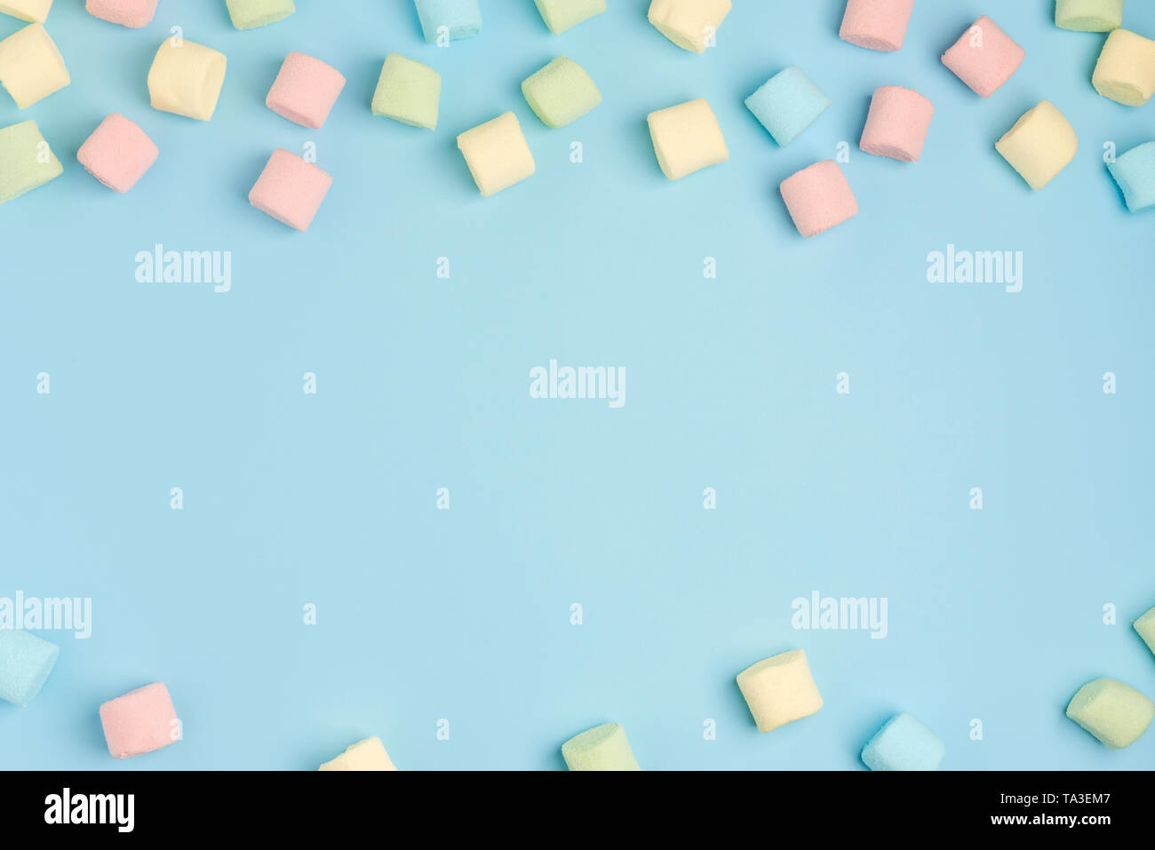 Blue paper background with marshmallow. Cozy sweet background - Stock Image