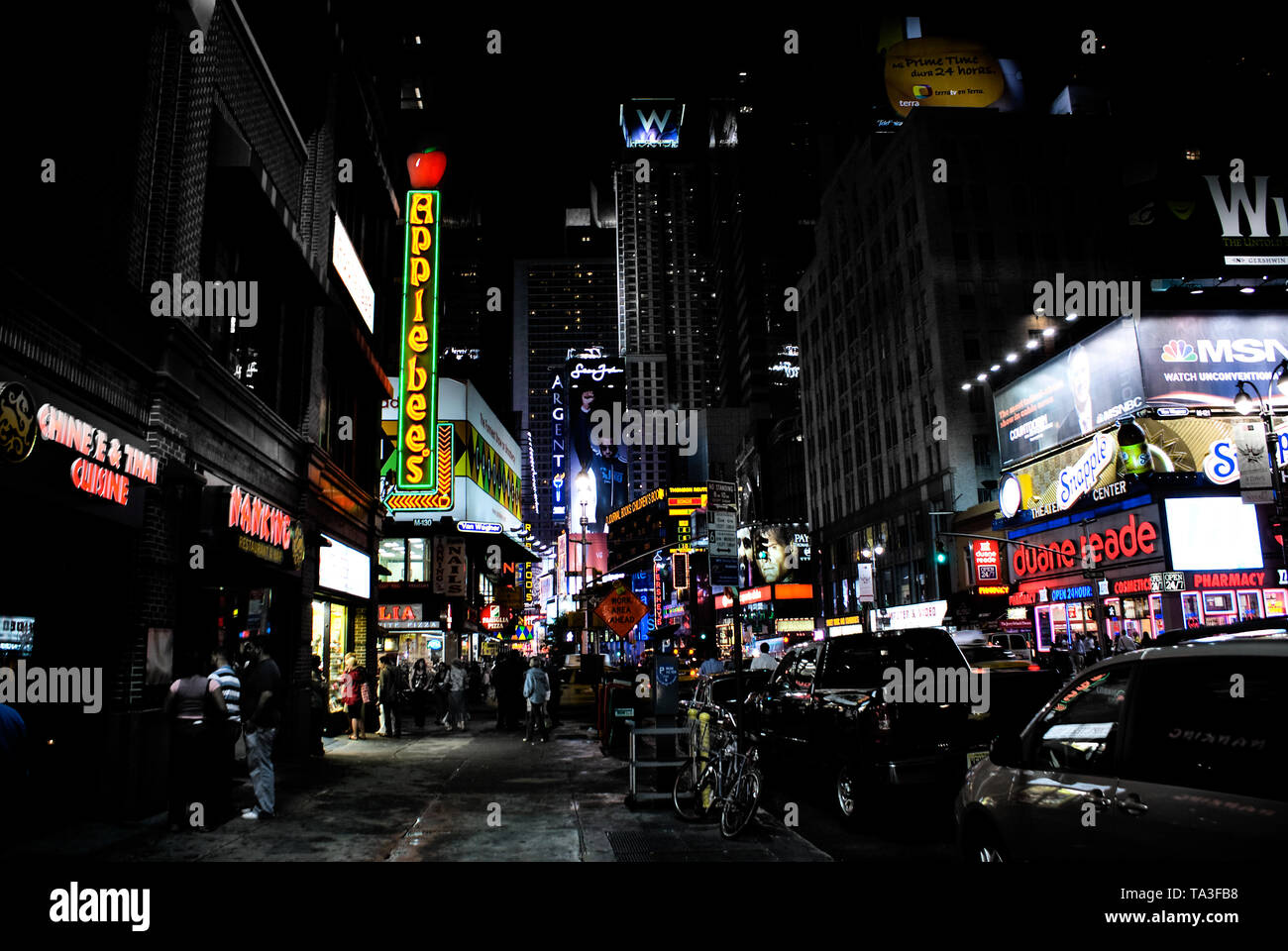 New york, usa - September 11, 2008: Nighttime image of the neon lights and advertising signs of a populous street in a business city in the United Sta - Stock Image