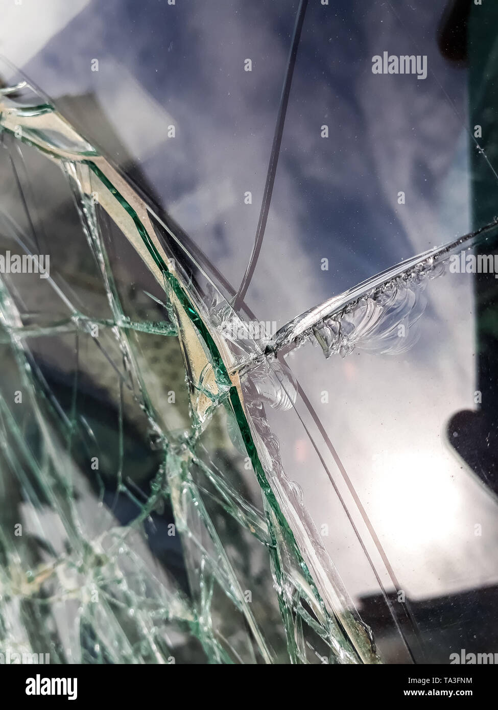 Broken windshield of abandoned and destroyed car, with broken glass. - Stock Image