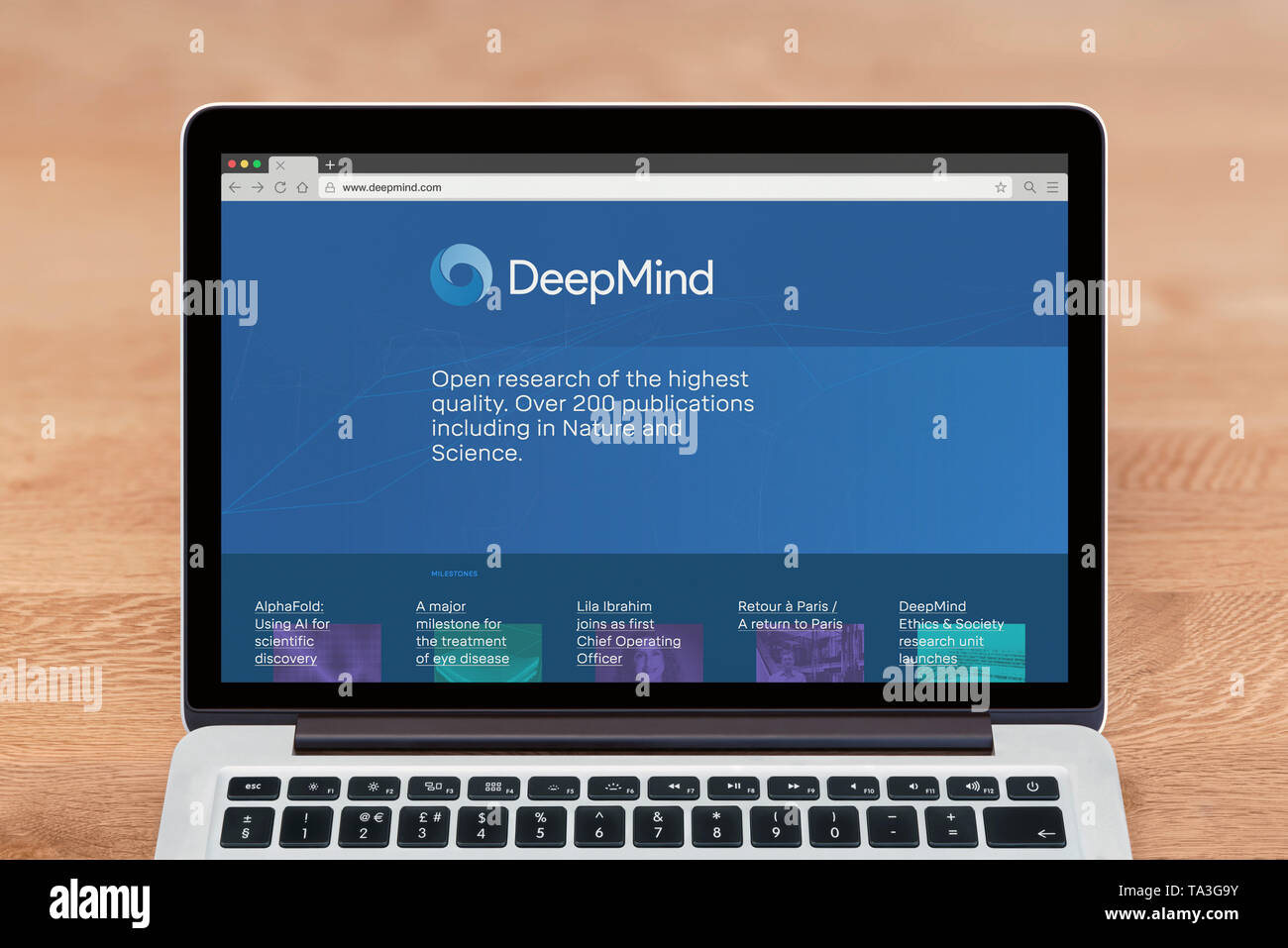 An Apple Macbook displays the Deepmind website (Editorial use only). - Stock Image