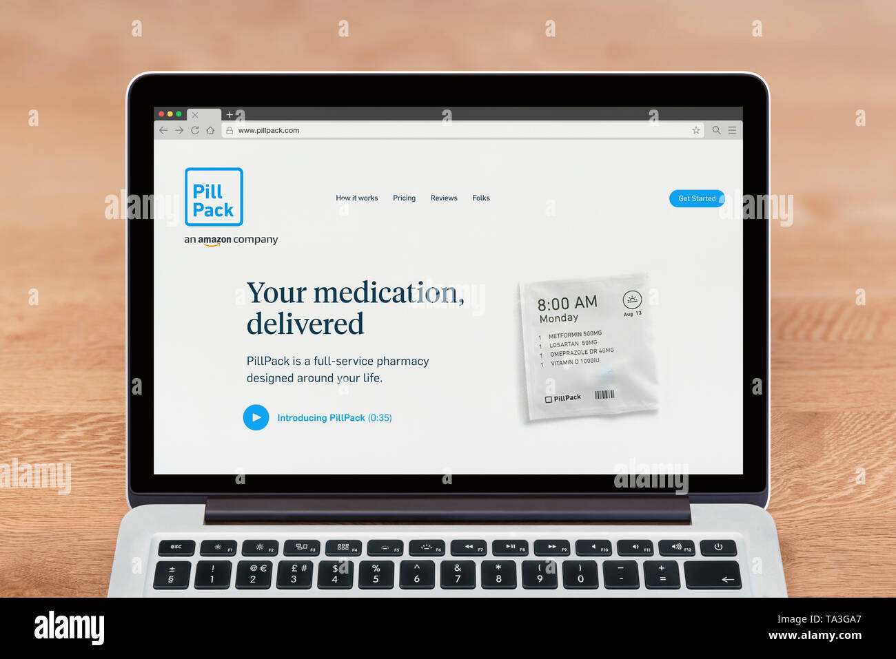 An Apple Macbook displays the PillPack website (Editorial use only). - Stock Image