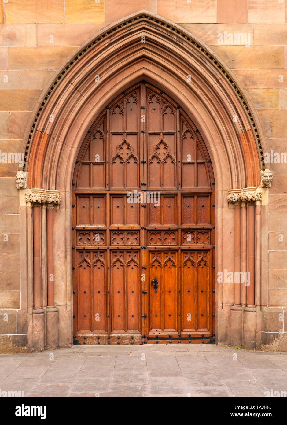 The west door of St Patrick's Cathedral in the city of Armagh, County Armagh, Ulster, Northern Ireland is the seat of the Archbishop of Armagh in the  - Stock Image