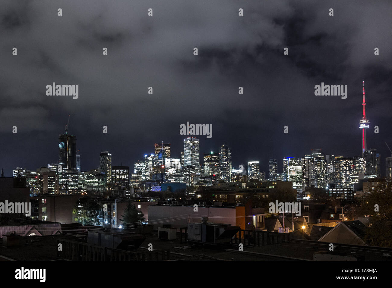 Toronto skyline, with the iconic towers and buildings of the Downtown and the CBD business skyscrapers at nights with lights. Toronto is the main city - Stock Image
