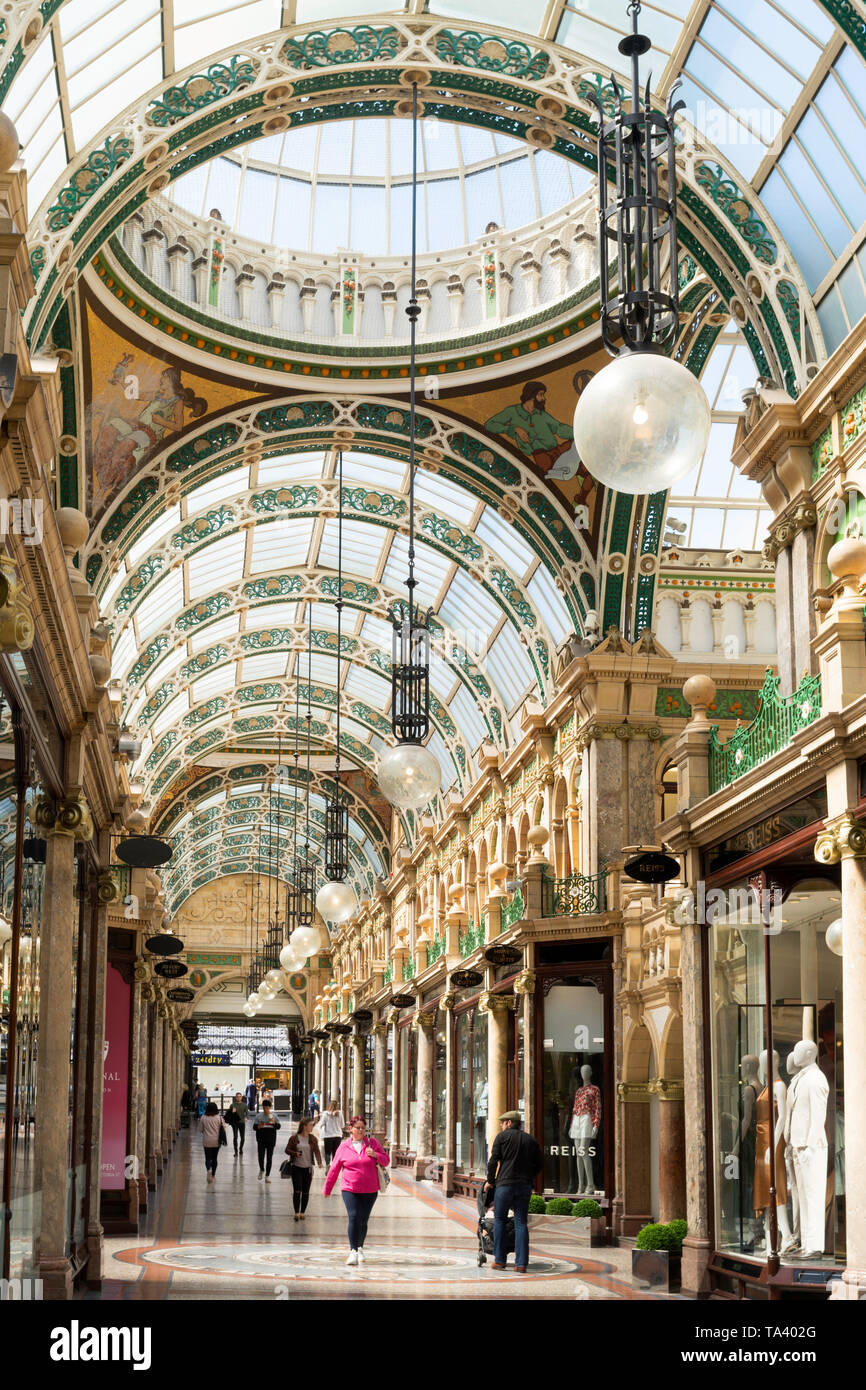 Shoppers walking through the County Arcade in  Leeds city centre, Yorkshire, England, UK - Stock Image