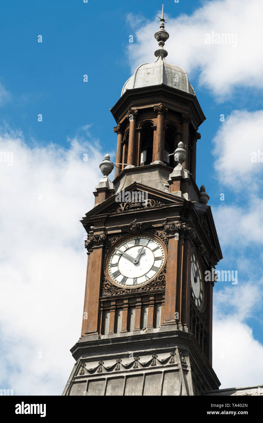 The ornate clock tower above the former general post office in Leeds city centre, Yorkshire, England, UK - Stock Image
