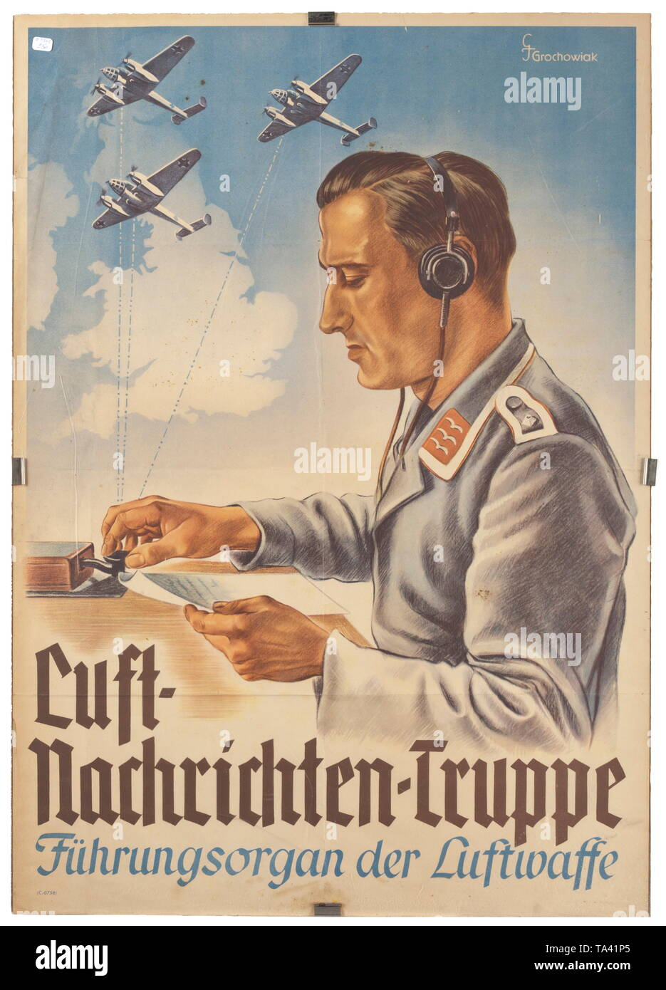 A poster advertising the 'Luft-Nachrichten-Truppe' (tr. 'airforce-signal-unit') design by Thomas Grochowiak (1914 - 2012) historic, historical, Air Force, branch of service, branches of service, armed service, armed services, military, militaria, air forces, object, objects, stills, clipping, clippings, cut out, cut-out, cut-outs, 20th century, Editorial-Use-Only - Stock Image