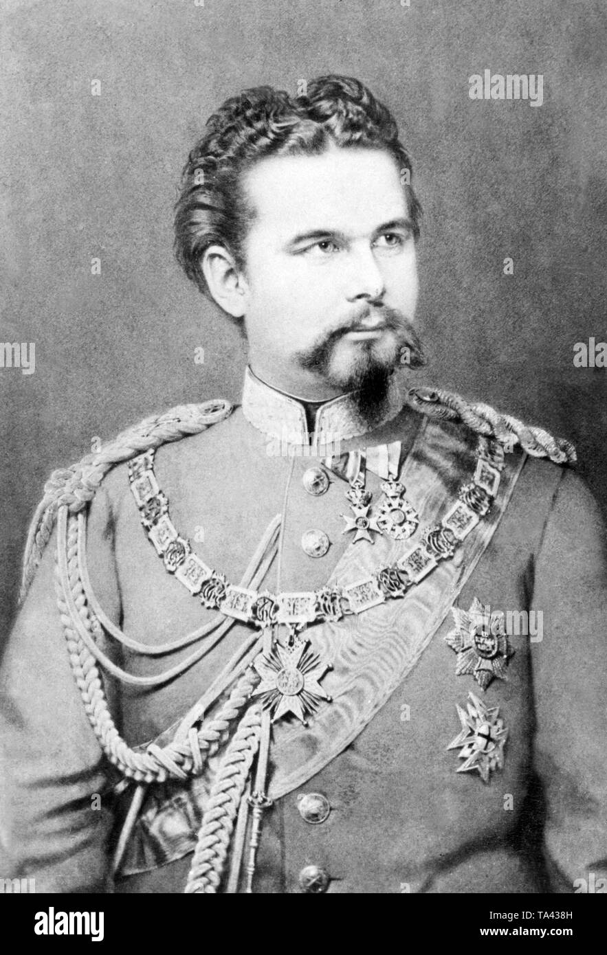 This photograph from 1875 shows King Ludwig II of Bavaria. King Ludwig II carries the Order of St. Hubert, the house order of the Wittelsbach and one of the four royal Bavarian orders.  After his deposition on June 9, 1886, his uncle Luitpold took over, as Prinzeregent, the governmental affairs of the Bavarian kingdom. Due to his activity as builder of many well-known Bavarian castles, King Ludwig II received the nickname 'Fairy Tale King'. - Stock Image