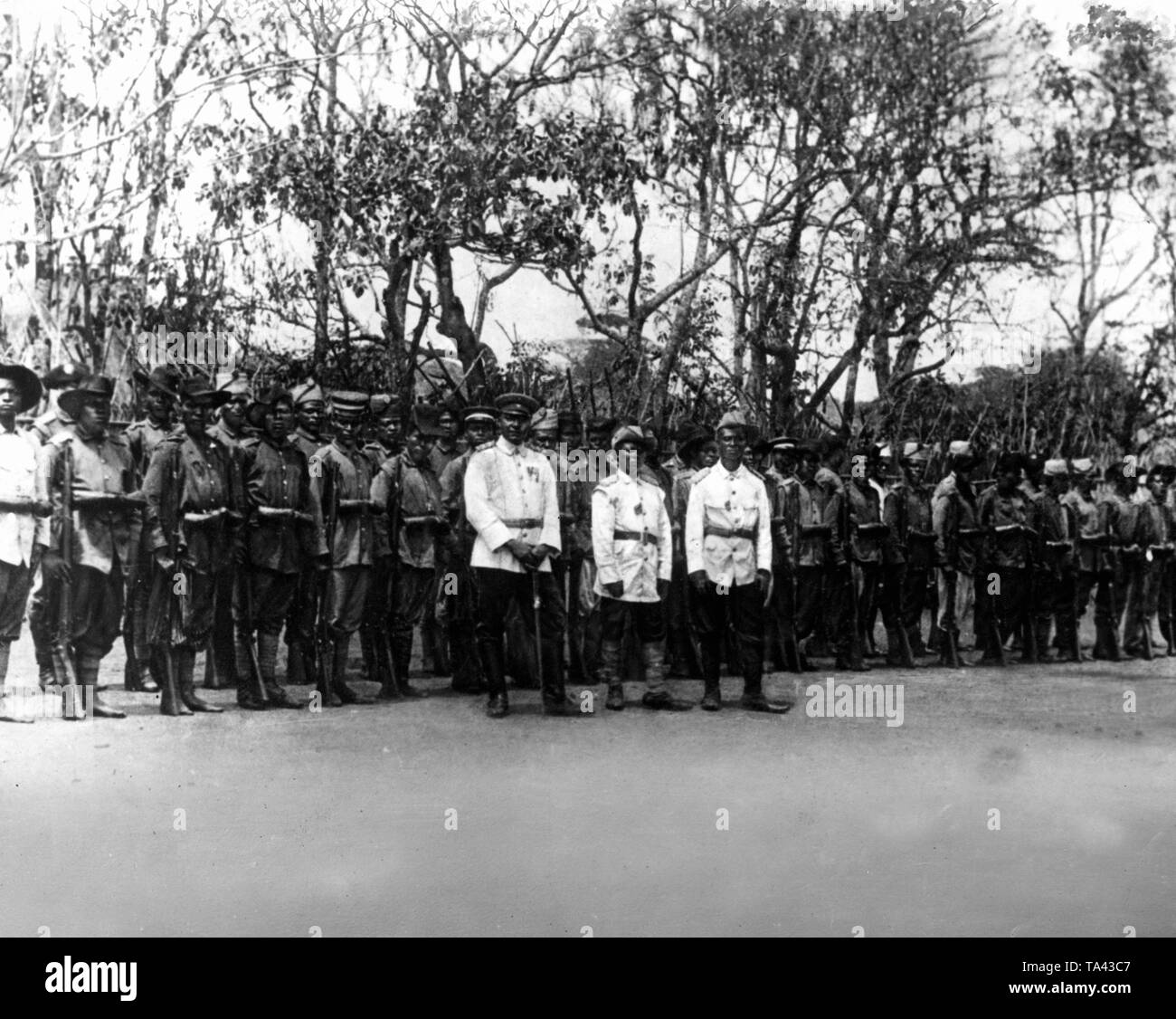 The private army: King Njoya of Bamum (middle group left) with his soldiers in uniforms after German colonial pattern. - Stock Image