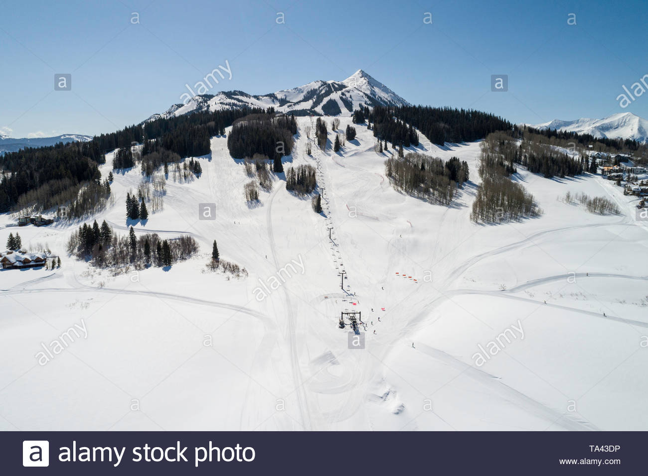Aerial view of the Gold Link chair lift with the peak of Crested Butte Mountain in the distance. Stock Photo