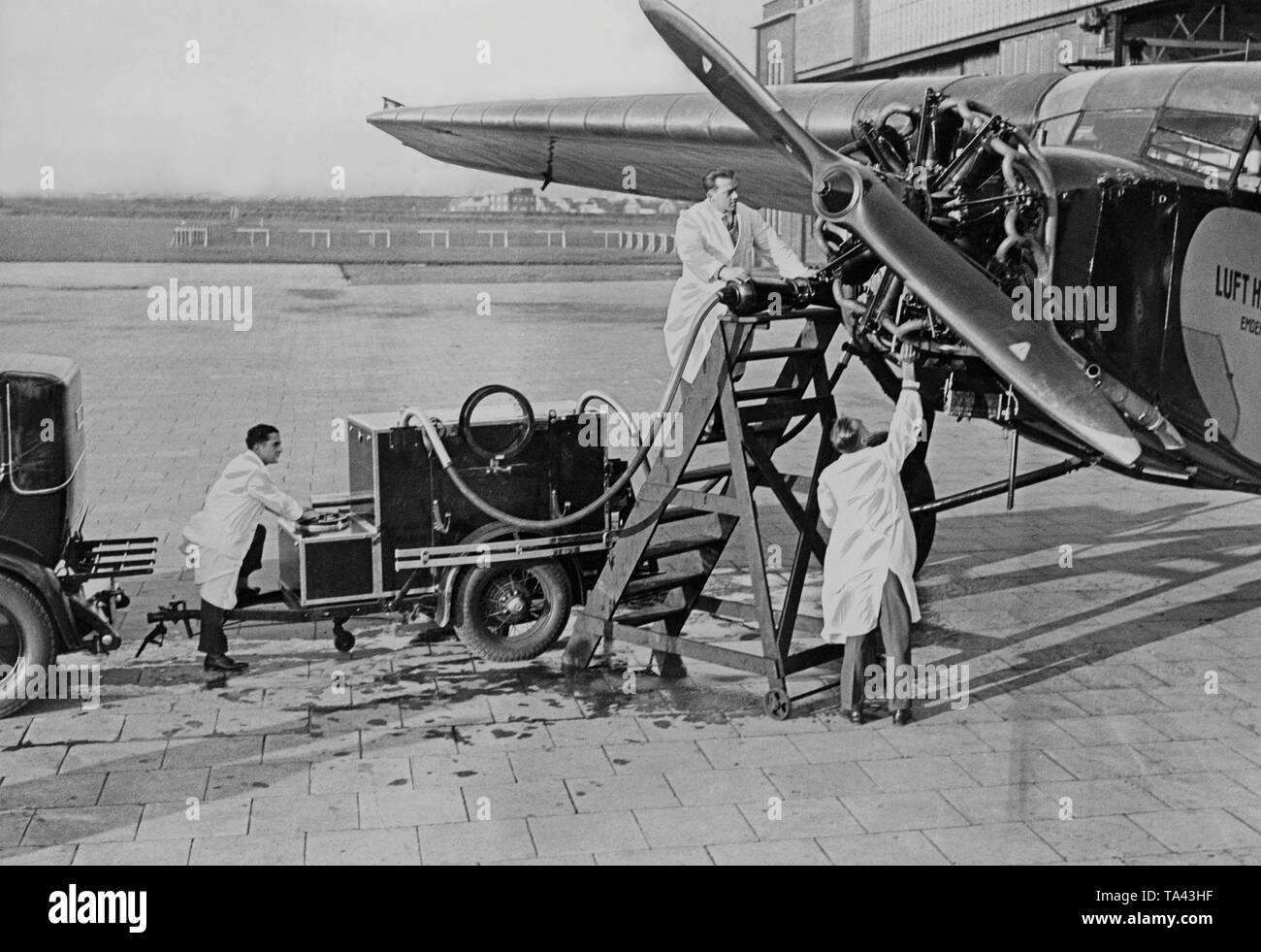 Mechanics of the Lufthansa check a radial engine of a Focke Wulf A17 'Moewe' ('Seagull'). The airplane bears the given name of 'Emden'. - Stock Image