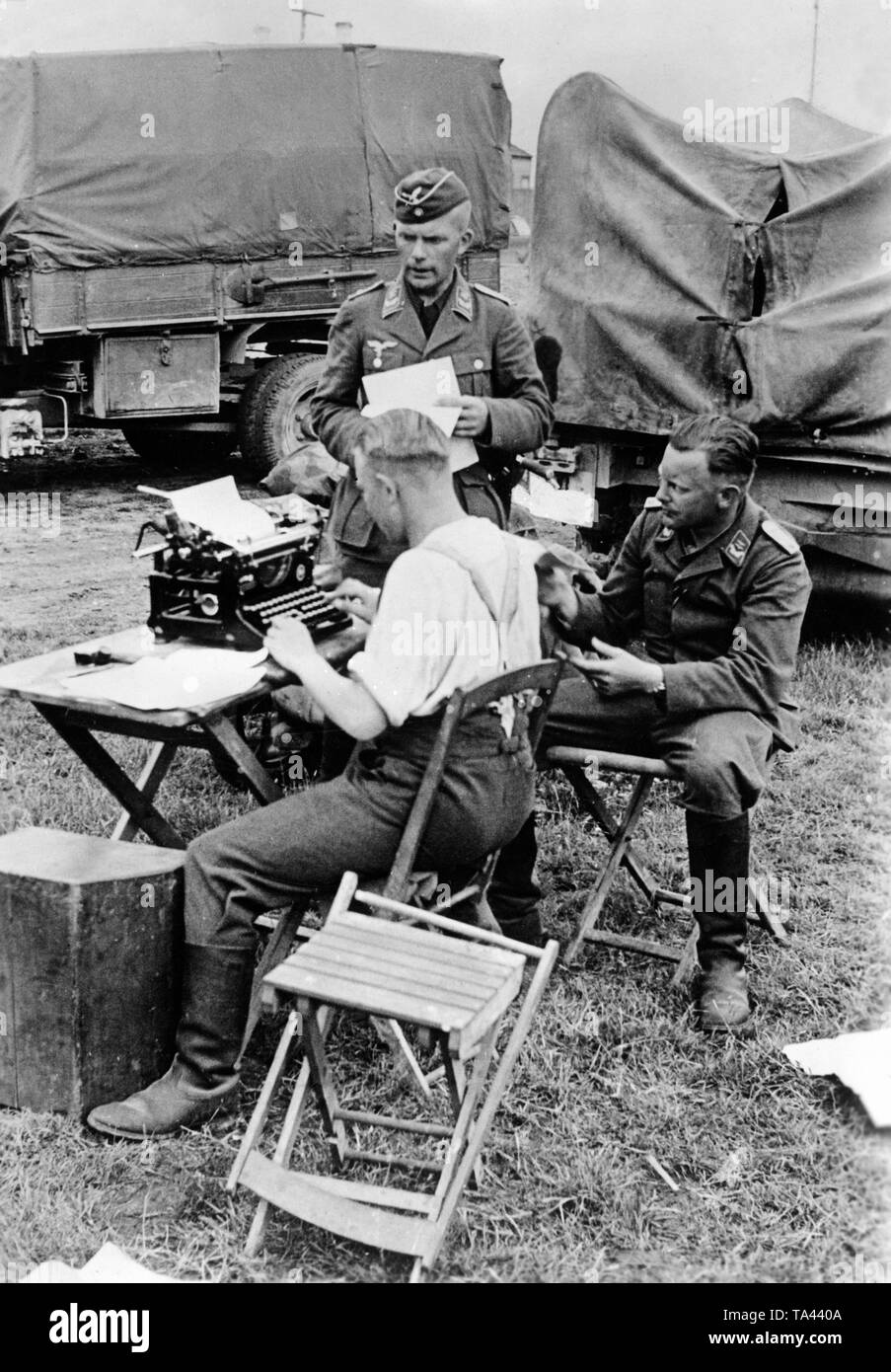 Soldiers of a signal battalion of the Luftwaffe process information on the eastern front. Here are written information for the command posts. Photo: war correspondent Luben. Stock Photo