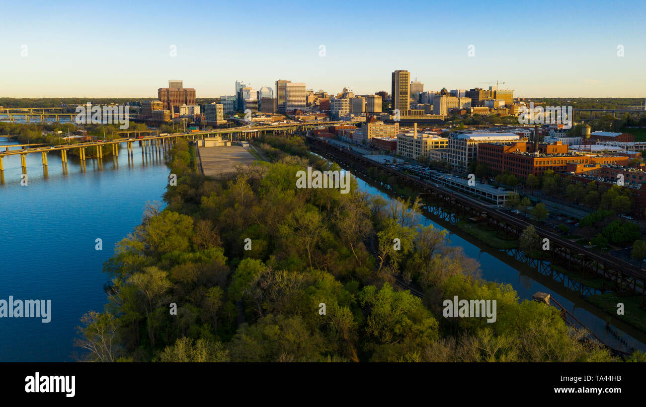 The railroad line travels along the riverfront heading into Richmond Virginia - Stock Image