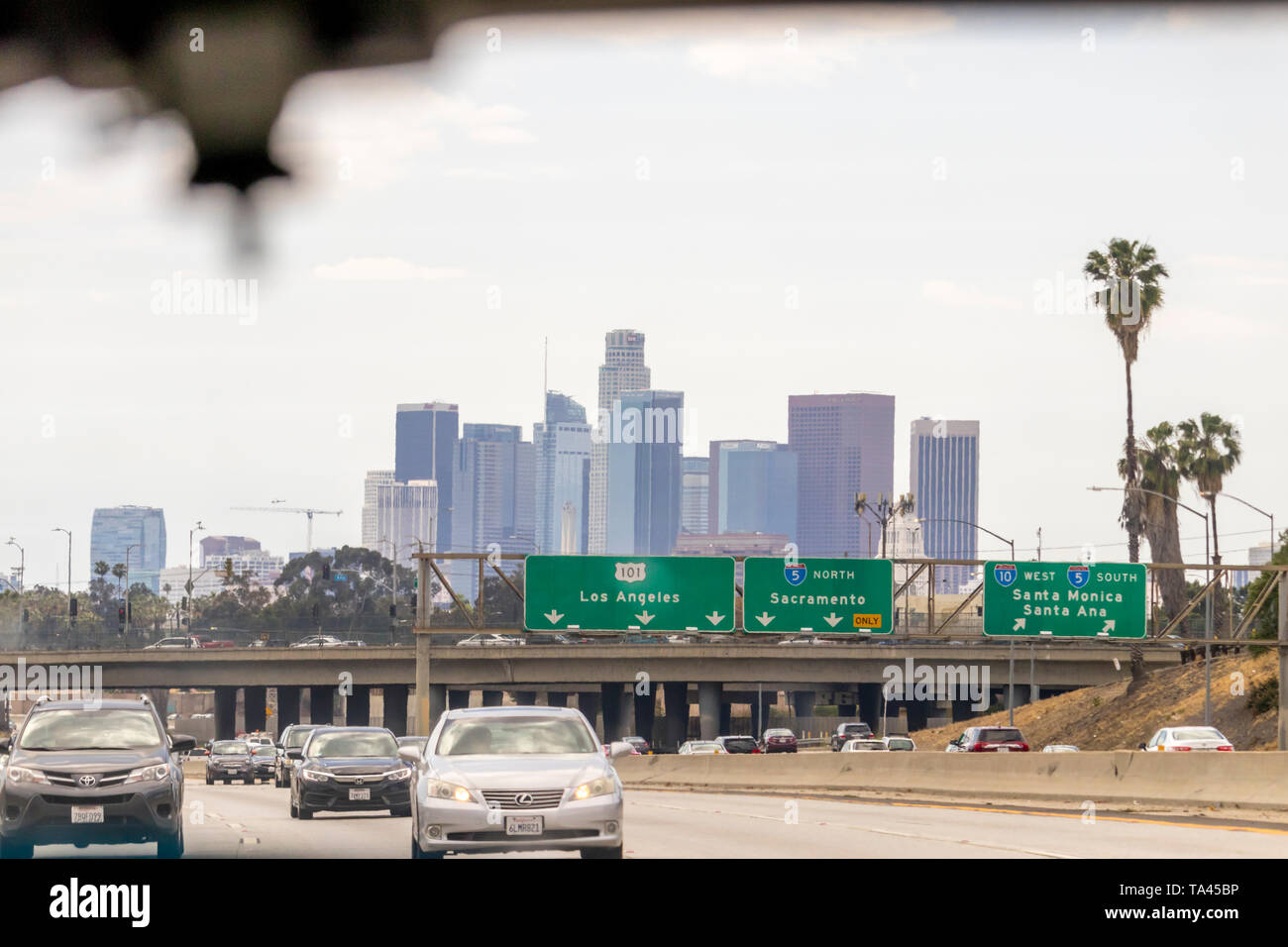 Los Angeles, California USA - May 2019: Downtown buildings skyline and signs on freeway indicating which lanes go to Los Angeles and which ones go nor Stock Photo