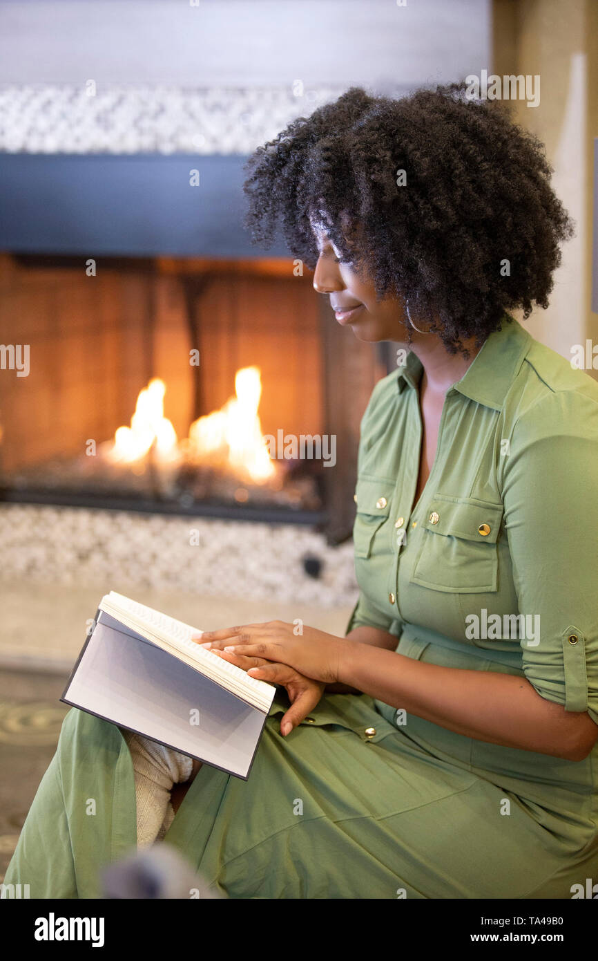Person Relaxing Fireplace Stock Photos & Person Relaxing
