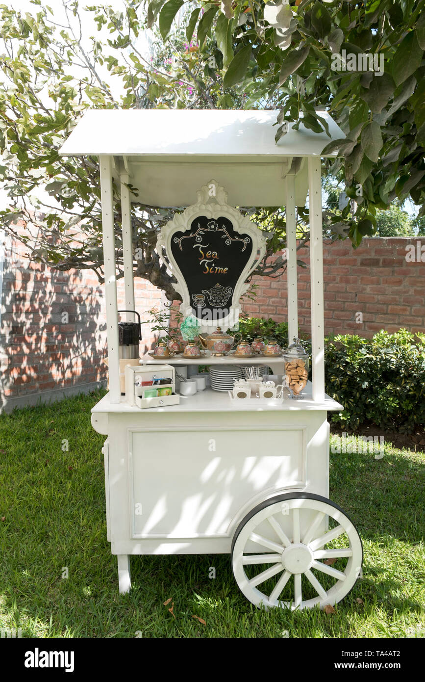Small and cozy cart for coffee and tea. With a slate. Wedding - Stock Image