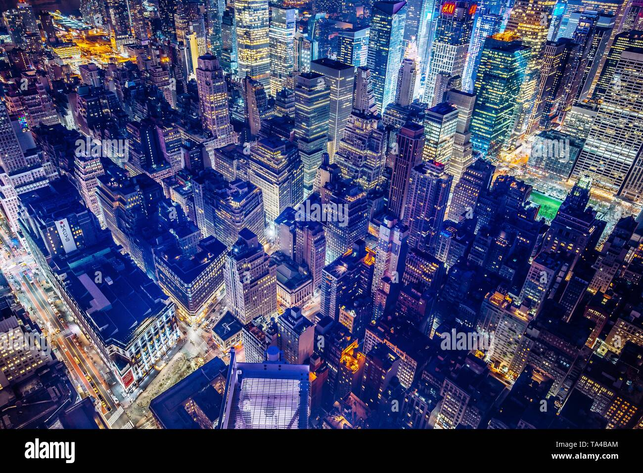 Beautiful futuristic aerial shot of New York City at night - Stock Image