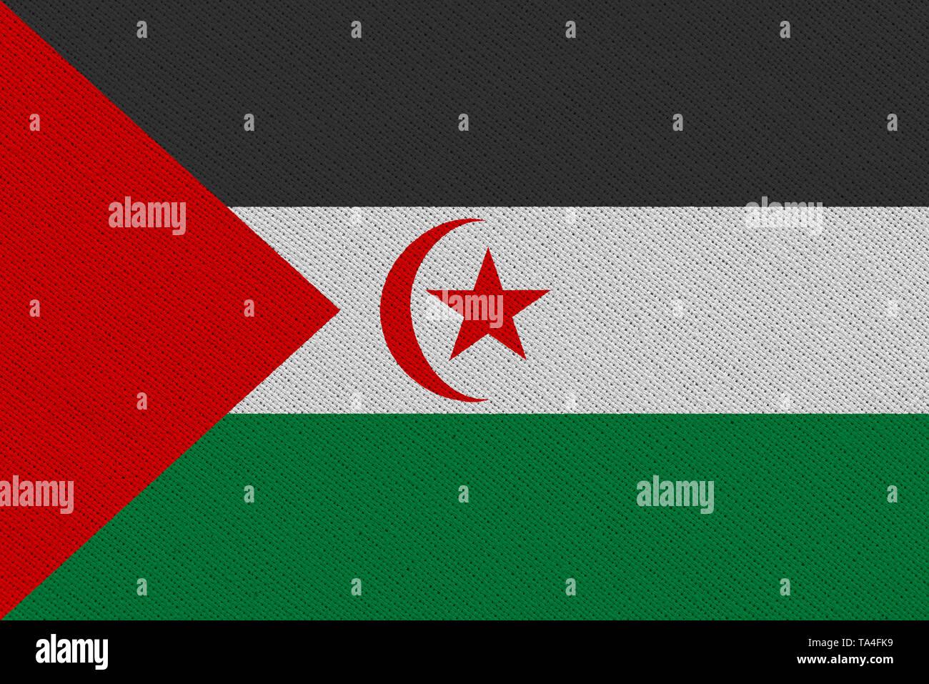 Sahrawi Arab Democratic Republic fabric flag. Patriotic background. National flag of Sahrawi Arab Democratic Republic - Stock Image